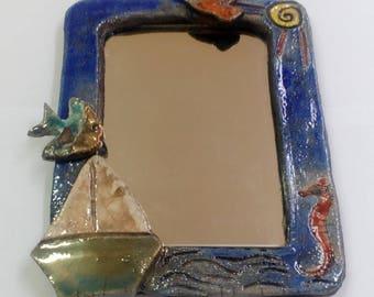 Ceramic raku mirror.