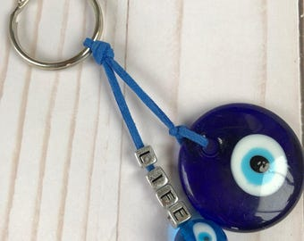 Key chain with evil eye large glass bead in blue suede cord