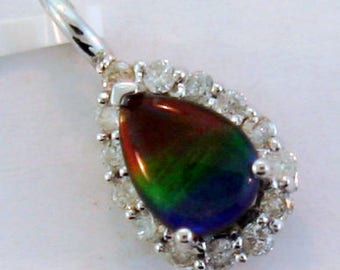AAA quality Canadian Ammolite and Diamond Pendant. Set on 14k White Gold .