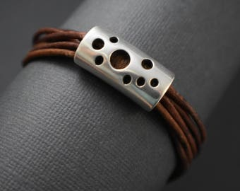 Bracelet - Perforated design spacer. Brown distressed round cord strings