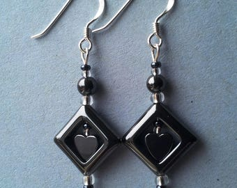 Hematite and silver earrings with heart insert. Silver hooks. Handmade