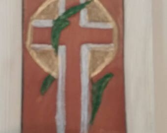 Carved leather cross on oak