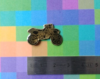 Vintage black and gold yamaha motorcycle enamel pins