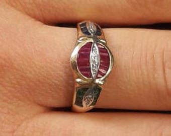 gold ring with sapphires, emeralds, rubies