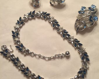 Trifari necklace, earring, and broach set.