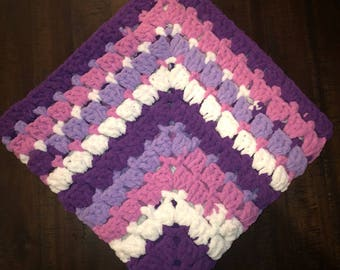 multi-colored purple, pink, and white baby girl blanket with matching newborn hat. Made with Bernat baby yarn