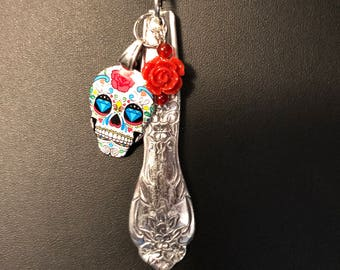 Recycled Sugar skull with red rose dangle on stainless steel floral spoon handle necklace.