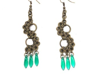 Antique brass earrings, with green daggers.