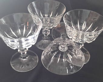 Arcoroc clear crystal stemmed dessert dishes with short and long deep wedges alternating around