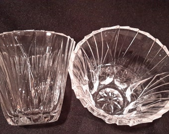 A set of clear crystal votive candle holder