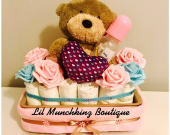 Beautiful flowery pink baby hamper for a baby girl