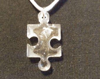 Hidden quartz in resin puzzle piece necklace