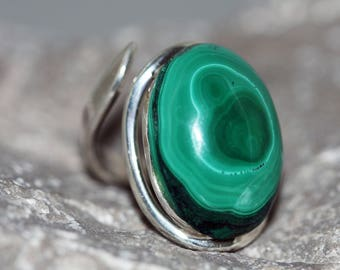 Malachite Ring. Elegant piece of Malachite fitted in sterling silver. Handmade & unique. Ring is adjustable.