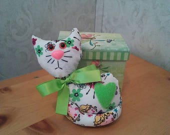 Country kitty in multicolored cotton print. Hypoallergenic stuffing. Safety lock eyes n nose. Felt heart. Measures 5 high.