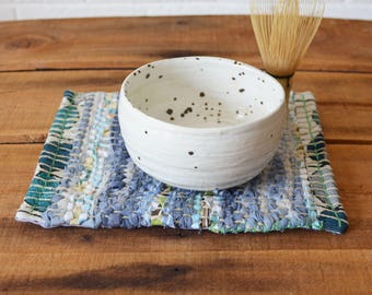 Hand woven mug rug, snack mat, placemat, table decoration. December Minimum Indigo Blue