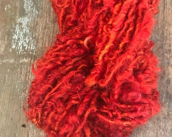 It's a Hard Knock Life, 44 yards handspun yarn, red orange art yarn, lockspun yarn, curly handspun yarn,