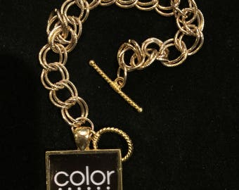 """7"""" gold chain with black Color Street 1"""" square charm under jewelers grade epoxy ."""
