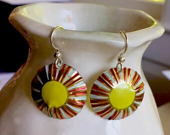 Sweet sun burst yellow earrings made from recycled tins.  Sterling Silver wires.  Super lightweight.