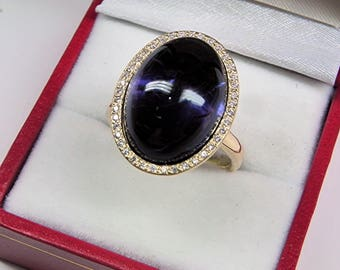 AAAA Iolite Cordierite 18 x 13mm  13.70 Carats   14K Yellow gold Diamond halo cabochon ring. 1524