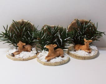 Wood slice deer ornaments with pine sprays and snow