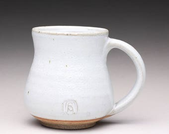 handmade pottery mug, ceramic teacup, coffee cup with orange shino and white wood ash glazes