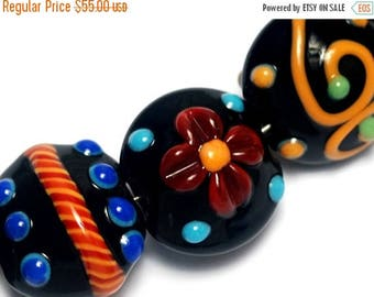ON SALE 35% OFF Glass Lampwork Bead Set - Seven Black Based Fiesta Lentil Beads 10201202