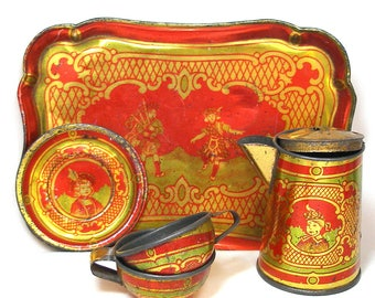 1900s Tin Toy Tea Set, Scottish kids in kilts. 6 pieces in gold, green & red.