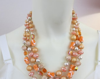 "Vintage Sherbert Orange 3 Strand Glass and Plastic Bead Necklace / 1950's Sparkler / Japan / 10"" drop"