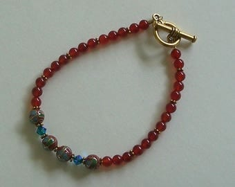 Delicate Carnelian Beaded Bracelet with Turquoise Preciosa Crystals and Fancy Beads by Carol Wilson of Je t'adorn