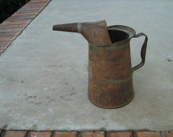 old vintage embossed 1/2 gallon liquid  U.S. standard N.Y.C. apprd D-2 metal oil can found in a old barn