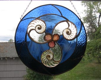 Center Nautilus Slices and Blue Glass in Spiral