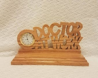 Doctor at work clock