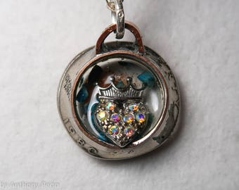 Princess crown set in hand hammered year 1980 US quarter pendant featuring turquoise shards and Oklahoma red dirt