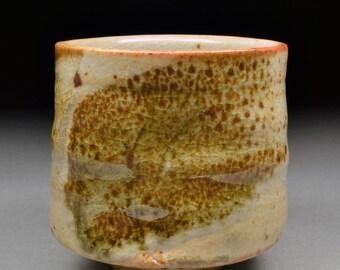 Twice fired Handmade Stoneware Yunomi Tea Cup glazed with Alberta Slip and White Shino