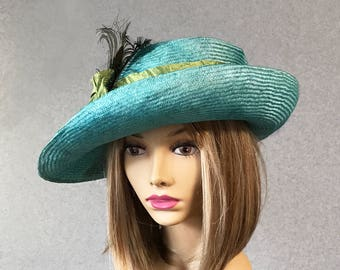 Christine, beautiful turquoise straw hat inspired from the Downton Abbey era, with a scrunchy silk dupioni sash, with peacock feathers