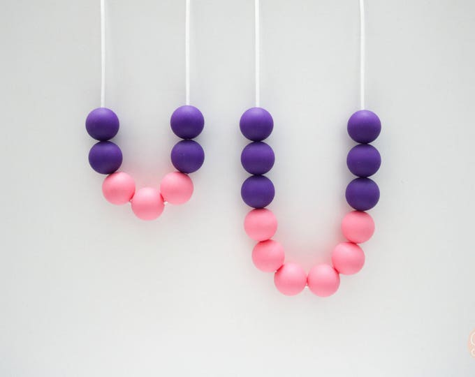 Mum and Bub set Purple and Pink Silicone Sensory Necklaces.