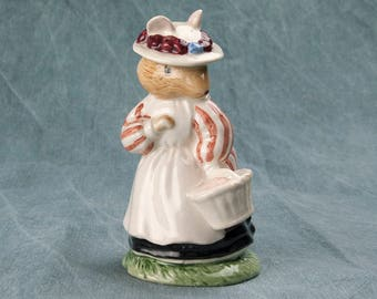 A Royal Doulton Lady Woodmouse figurine from the Brambly Hedge Gift Collection by Jill Barklem, model D BH 5. This is so whimsical and cute.