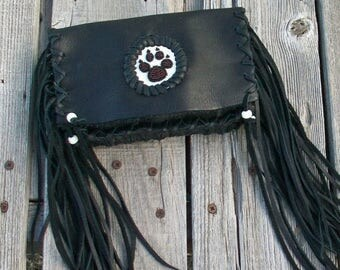 ON SALE Black leather clutch with fringe and a wolf paw totem