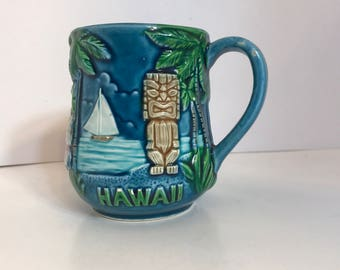 Vintage Souvenir Mug from Hawaii Embossed Hibiscus Flower, Sailboat, Palm Trees and Tiki