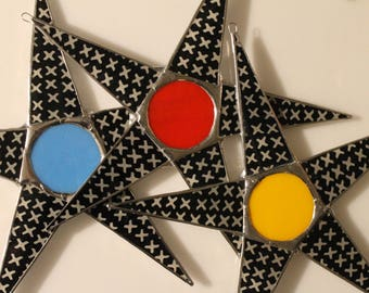 Hugs and Kiss Star- glass star with lacquered fabric under glass, black and white x's with art glass center, 10 inch glass star