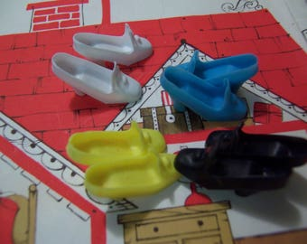 four vintage pairs of barbie shoes