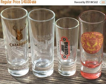 SET OF 4 ManCave Tequila Shot Glasses Vintage Cuervo 1980s Don Julio 1990s Cazadores 1990s Puerto Vallarta Mexico  1990s  MINT Condition