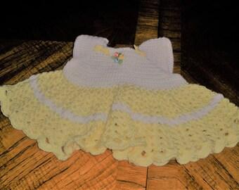 Hand made yellow and white crochet baby dress