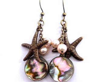 Starfish charm abalone earrings with pink pearl dangles on chain, dark brass. Summer pastel charm earrings, boho style beach theme jewelry