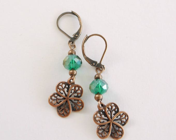 vintage style dangle earrings with green czech glass bead and filigree flower pendants