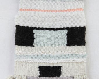 Sage, peach, black and cream woven wall hanging weaving