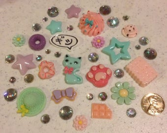 Aggravated cat Decoden kit collection pastel tones rainbow rhinestones kawaii phone case decoration