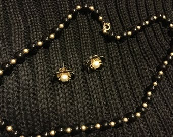 Gold and black, with pearl center. Vintage costume jewelry. Necklace and pierced earings.