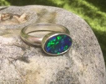 Opal in silver ring.
