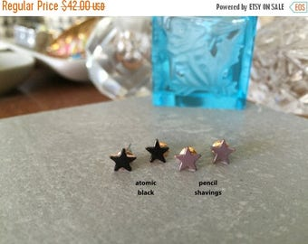 60% OFF Sale STAR studs >> tiny atomic black >>  second hole.  or first.  whatevs. << proceeds donated to Humane Society
